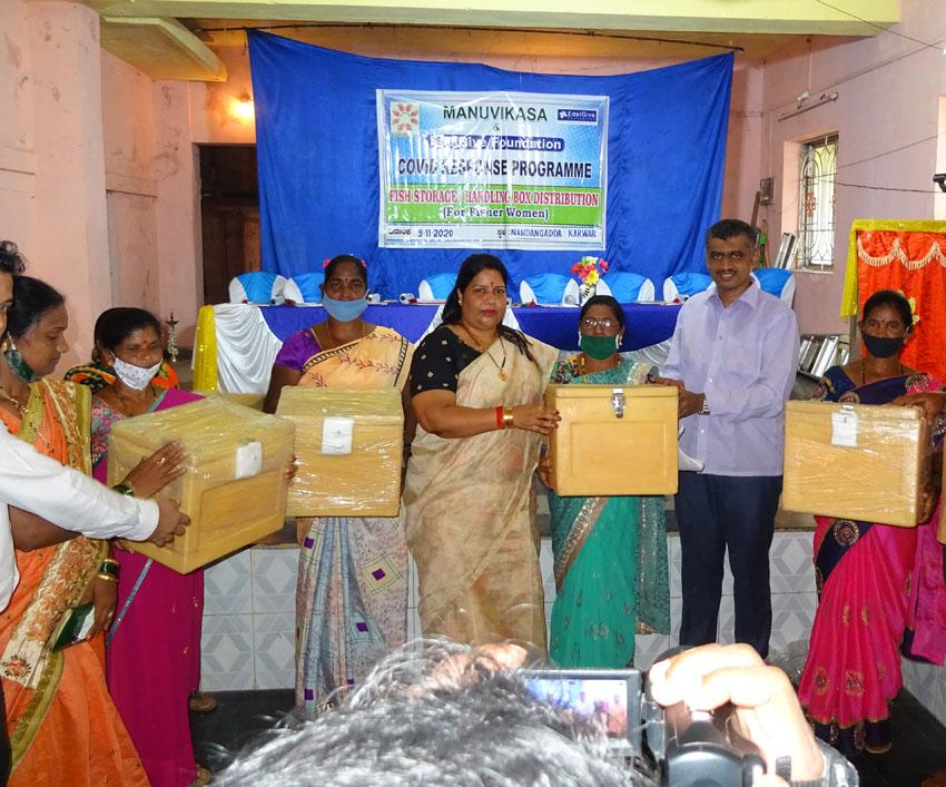 Fish box distribution to fisher women